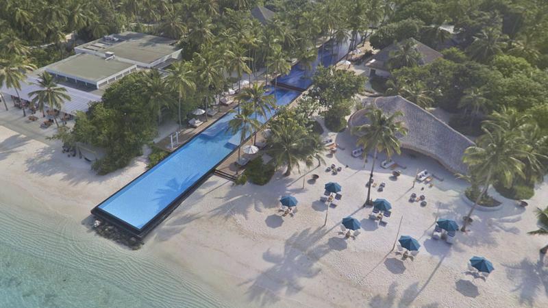 Esta piscina atravessa uma ilha inteira. É um verdadeiro destino de sonho