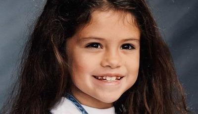 Cantora e atriz norte-americana recorda infância. Reconhece?