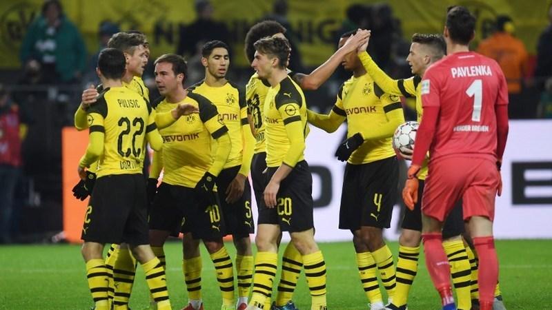 Raphael Guerreiro ajuda Dortmund a reforçar a liderança na Alemanha