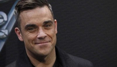 Robbie Williams explica gesto obsceno na abertura do Mundial