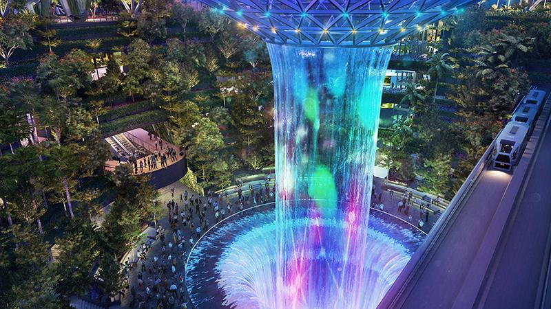 Tem 40 metros de altura e fica dentro de um aeroporto. É a maior cascata interior do mundo