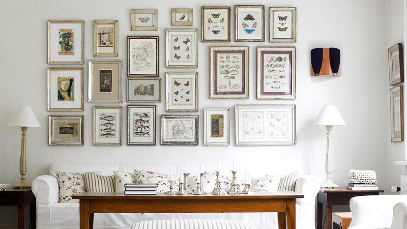 Como dar vida a uma parede com quadros e fotografias