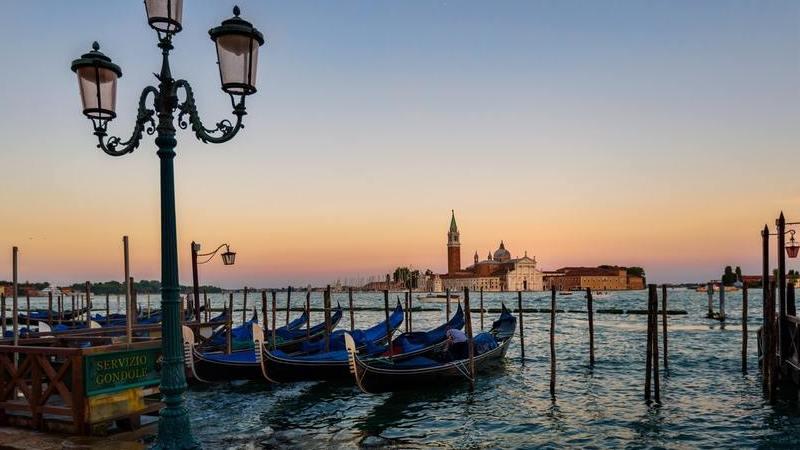 Um nascer do sol em Veneza numa viagem de Lua de Mel